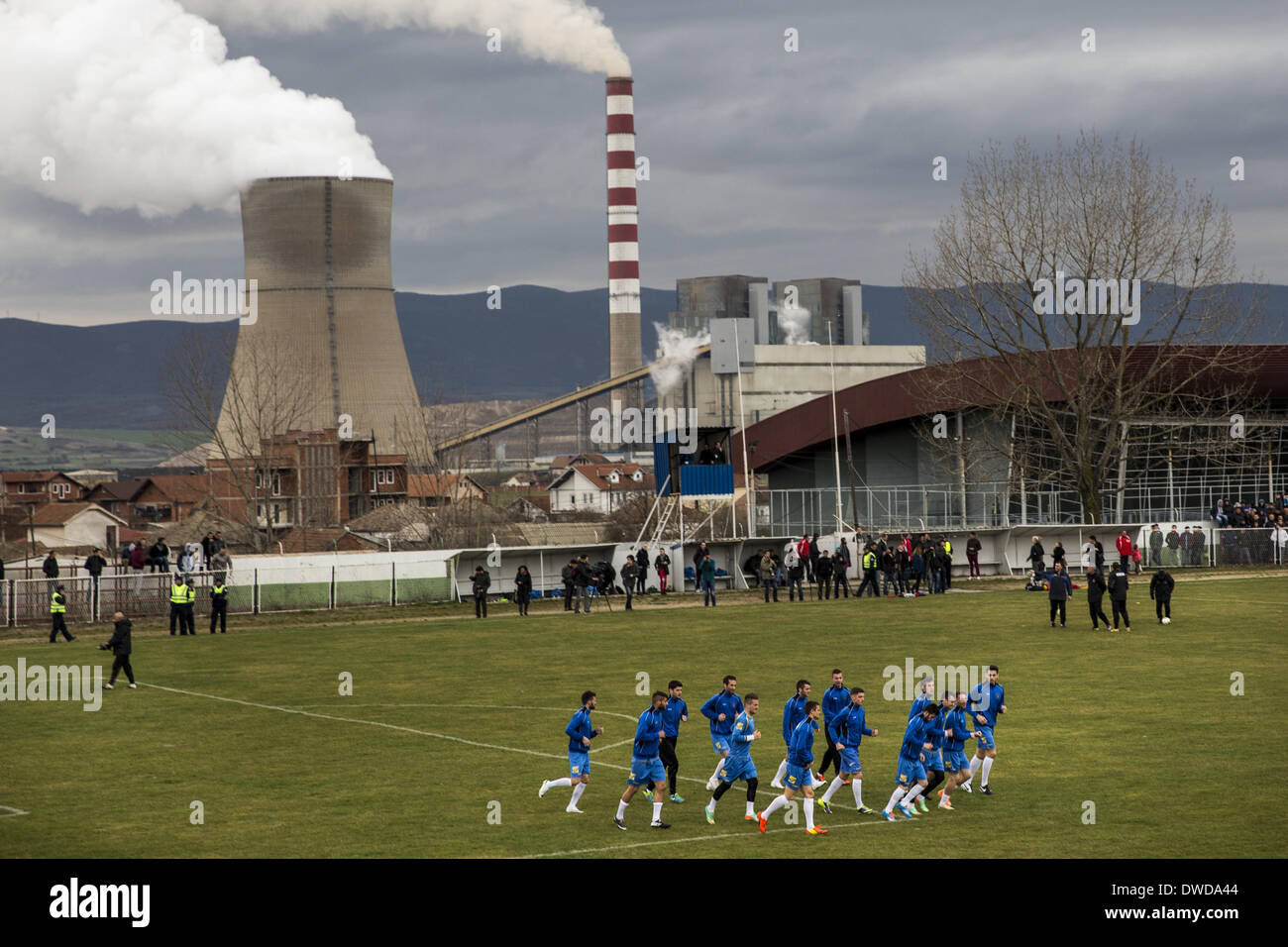 Pristina, Kosovo. 3rd Mar, 2014. Members of the Kosovo National Team practice at the KeK stadium on the Kastriot/Obilic district of Pristina, near the Kosovo Power Station, described as the worst single-point source of pollution in Europe. The will play their first FIFA sanctioned match, a friendly game against Haiti, on Wednesday March 5. PHOTO BY JODI HILTON/NURPHOTO © Jodi Hilton/NurPhoto/ZUMAPRESS.com/Alamy Live News - Stock Image