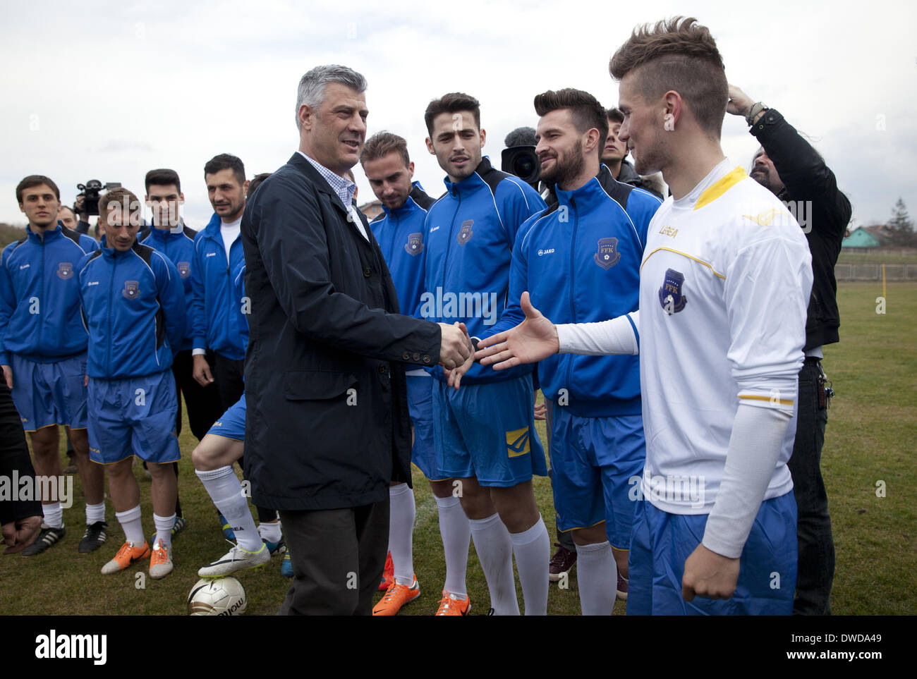 Pristina, Kosovo. 4th Mar, 2014. Kosovo's Prime Minister Hashim Thaci congratulates members of the Kosovo National Team before practice at the KeK stadium on the Kastriot/Obilic district of Pristina. The will play their first FIFA sanctioned match, a friendly game against Haiti, on Wednesday March 5. PHOTO BY JODI HILTON/NURPHOTO © Jodi Hilton/NurPhoto/ZUMAPRESS.com/Alamy Live News - Stock Image