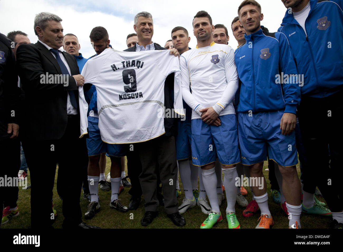 Pristina, Kosovo. 4th Mar, 2014. Kosovo's Prime Minister Hashim Thaci stands with members of the Kosovo National Team before practice at the KeK stadium on the Kastriot/Obilic district of Pristina. The will play their first FIFA sanctioned match, a friendly game against Haiti, on Wednesday March 5. PHOTO BY JODI HILTON/NURPHOTO © Jodi Hilton/NurPhoto/ZUMAPRESS.com/Alamy Live News - Stock Image
