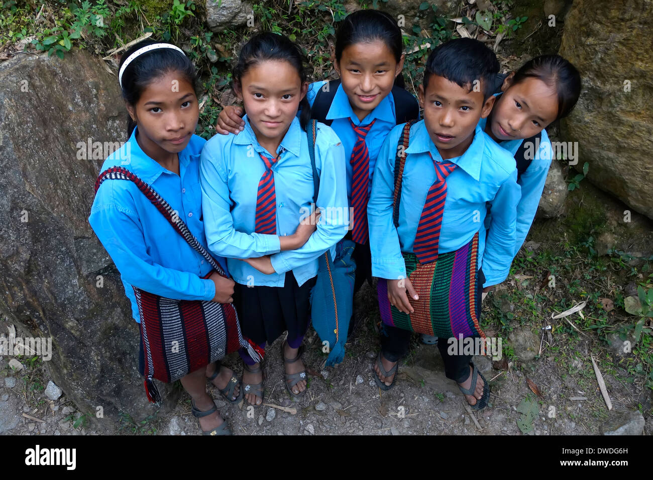 Scool children on a trail in the Gorkha region of Nepal. - Stock Image