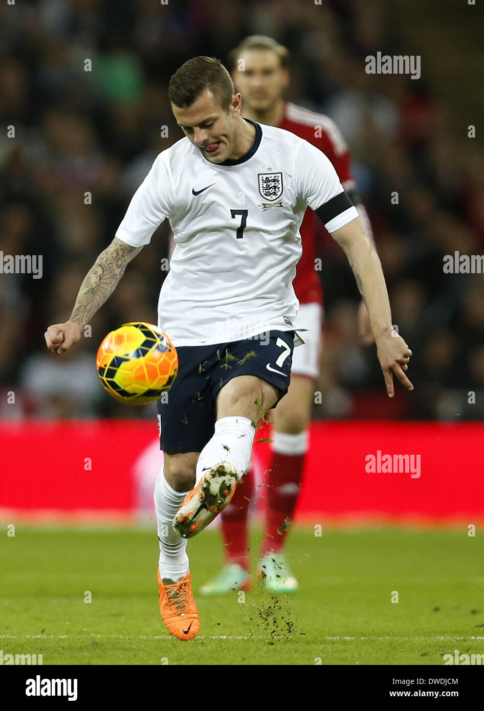 London, UK. 5th Mar, 2014. Jack Wilshere of England passes the ball during an international friendly soccer match between England and Denmark at Wembley Stadium in London, Britain on March 5, 2014. England won 1-0. Credit:  Wang Lili/Xinhua/Alamy Live News - Stock Image