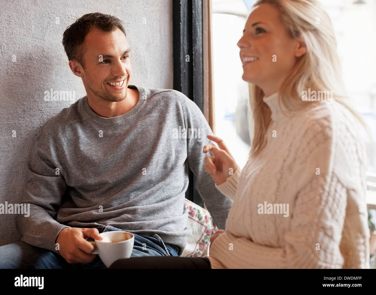 Happy young couple spending quality time at cafe - Stock Image