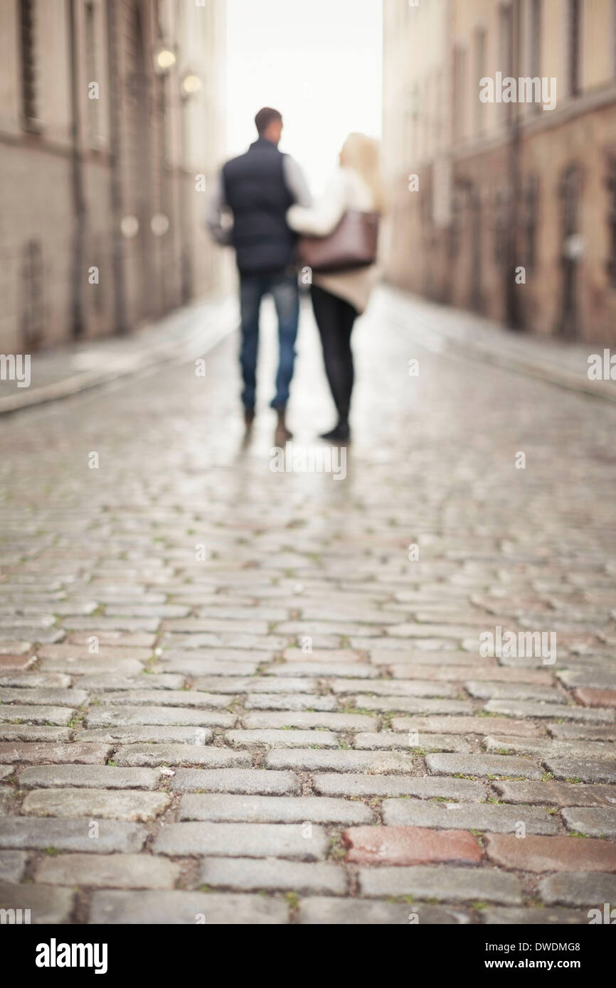 Surface level of street with couple in background - Stock Image