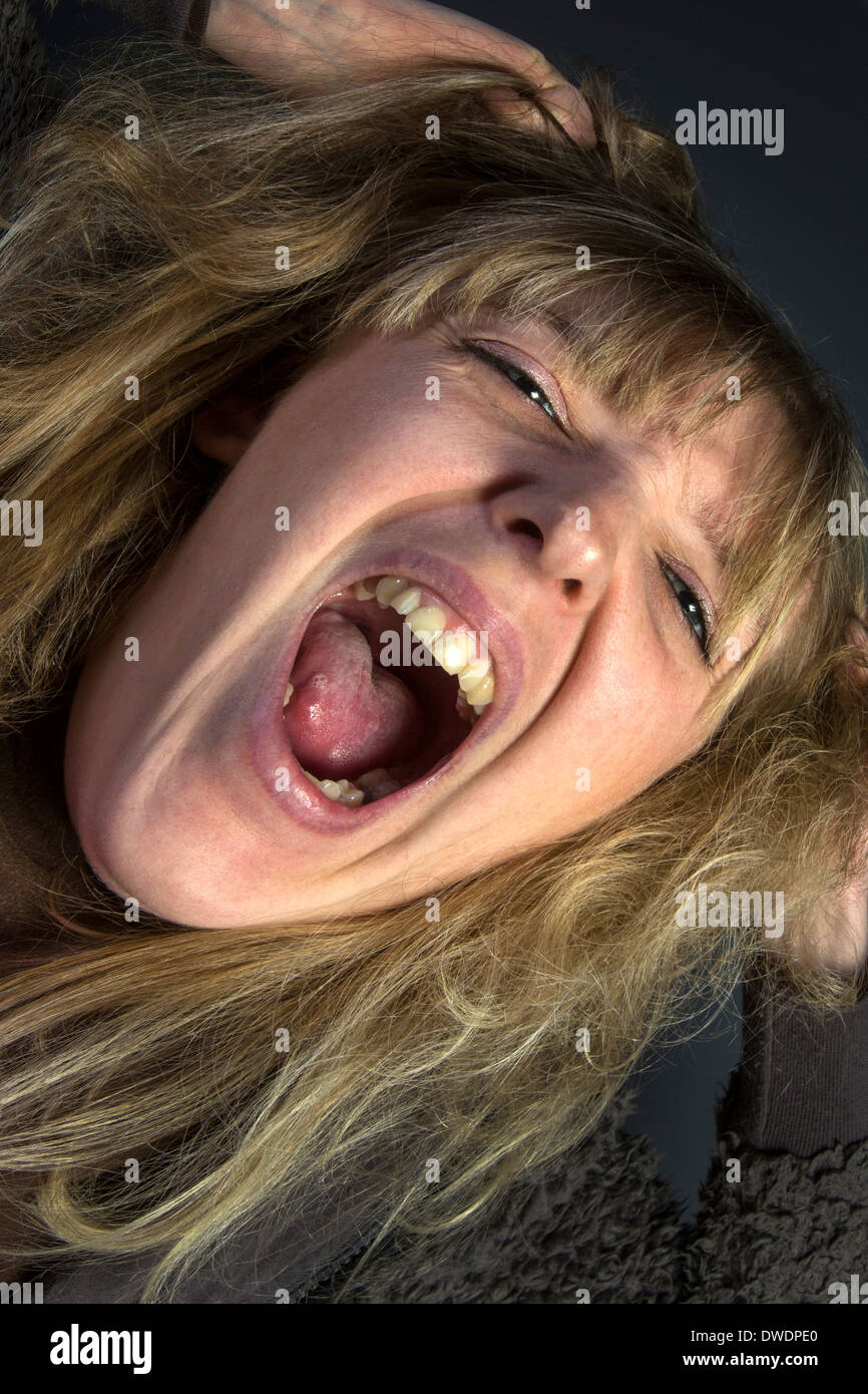 An hysterical young woman - Stock Image