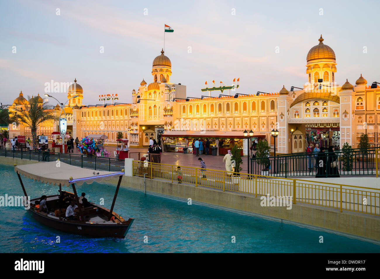 India Pavilion and canal with abra tour boat at Global Village tourist cultural attraction in Dubai United Arab Emirates - Stock Image