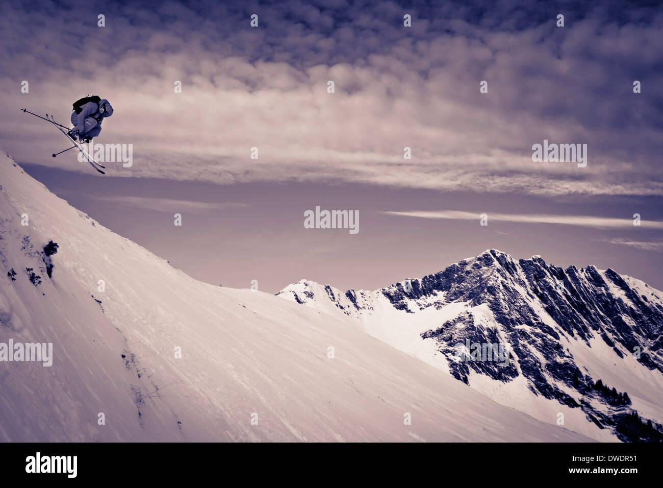 Austria, Tyrol, Kitzbuehel, Man off-piste skiing - Stock Image