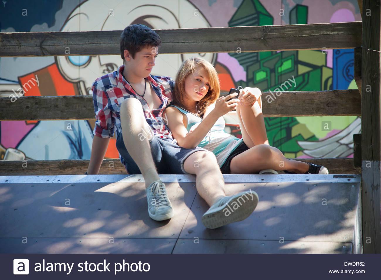 Teenage couple being bored - Stock Image