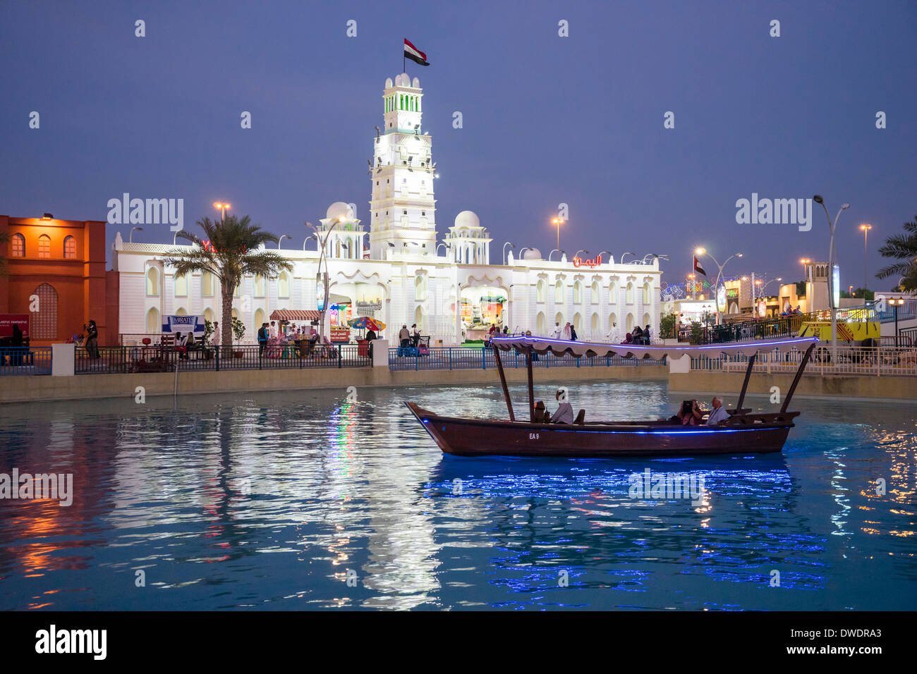 Yemen Pavilion and canal with abra water taxi at  Global Village tourist cultural attraction in Dubai United Arab Emirates - Stock Image
