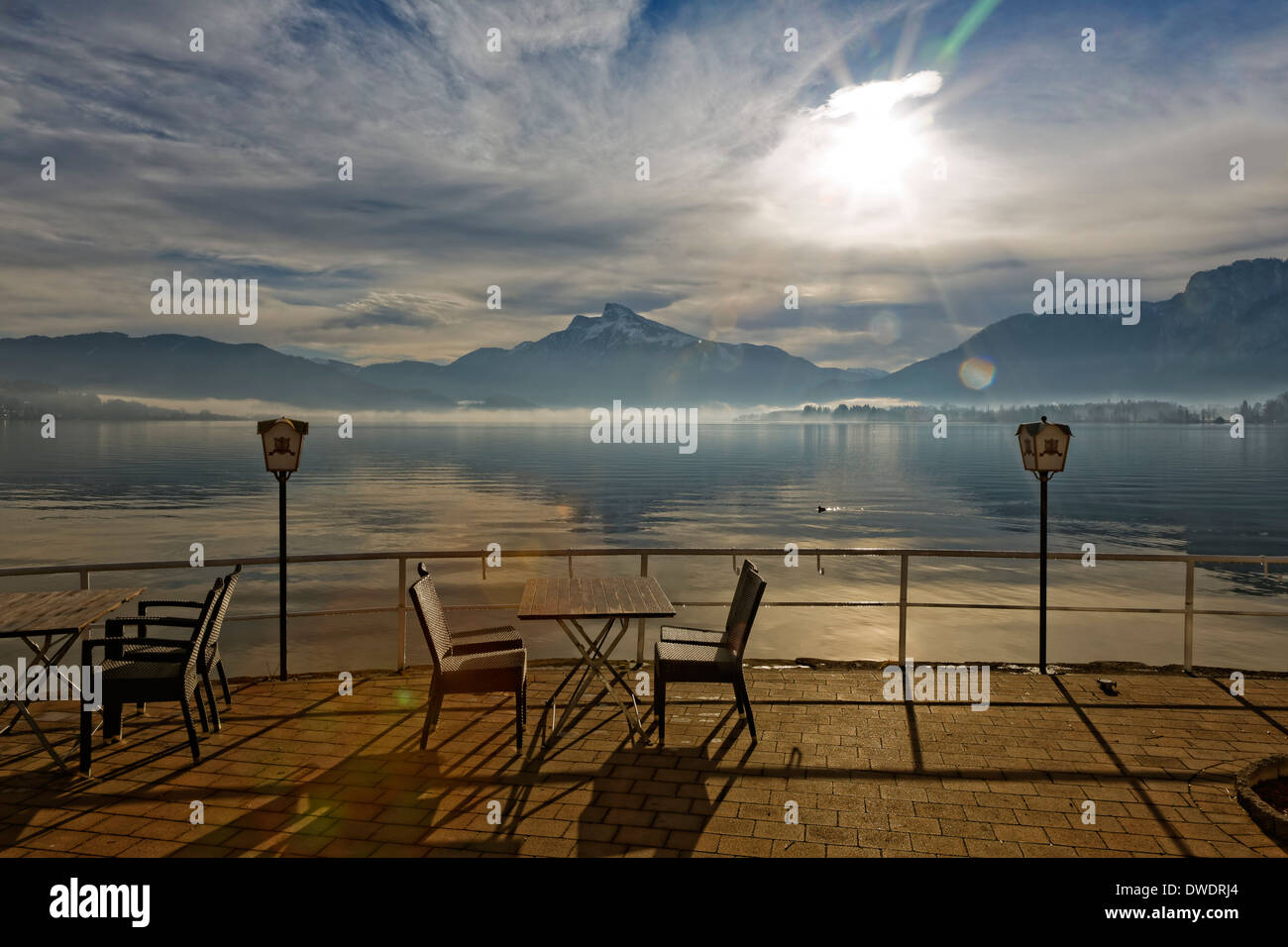 Austria, Upper Austria, Salzkammergut, Lake Mondsee at sunrise, in the background Mountain Schafberg Stock Photo
