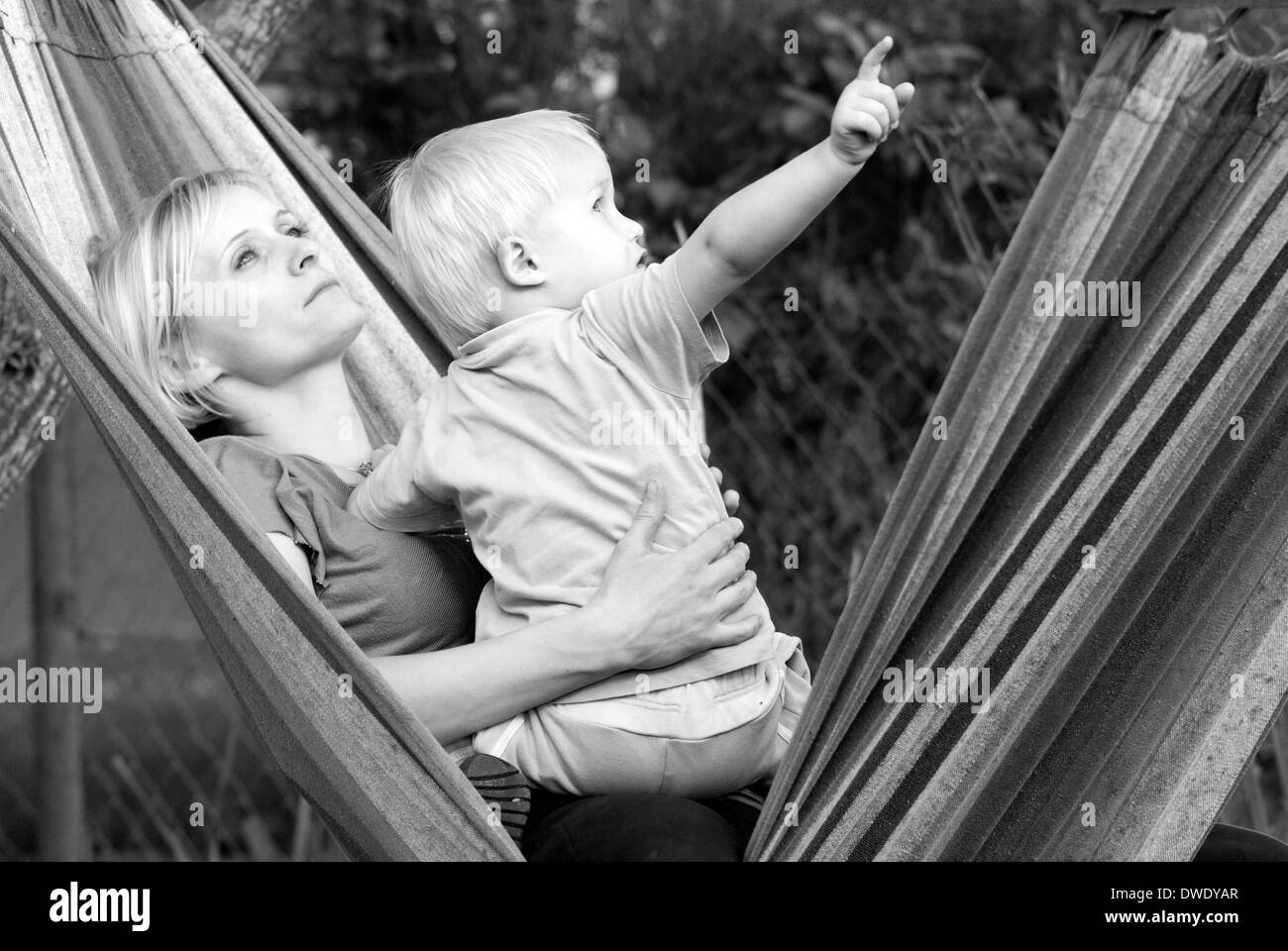 Mother with her son enjoying the nature and looking at something. - Stock Image