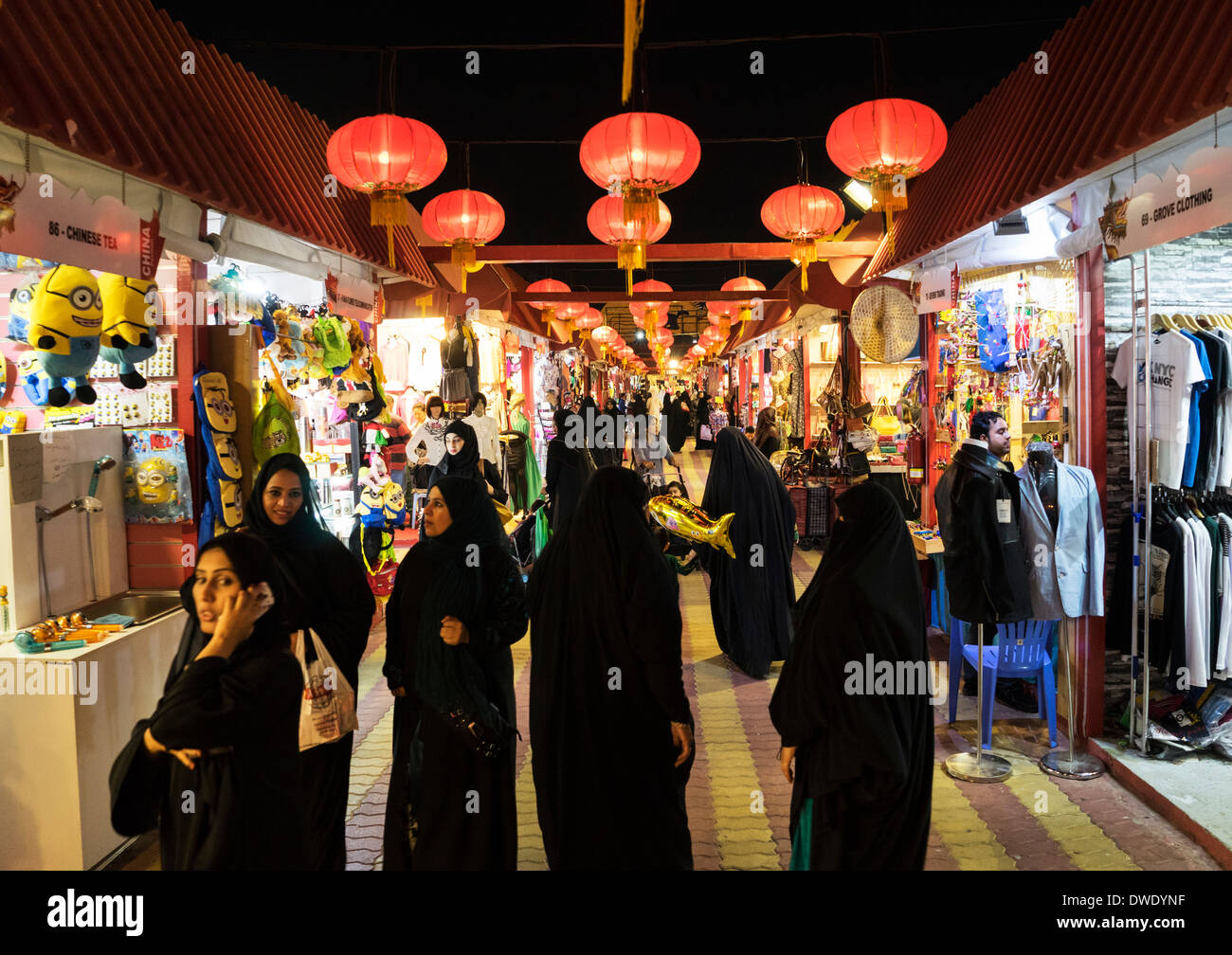Women shopping in arcade at China Pavilion at Global Village tourist cultural attraction in Dubai United Arab Emirates - Stock Image