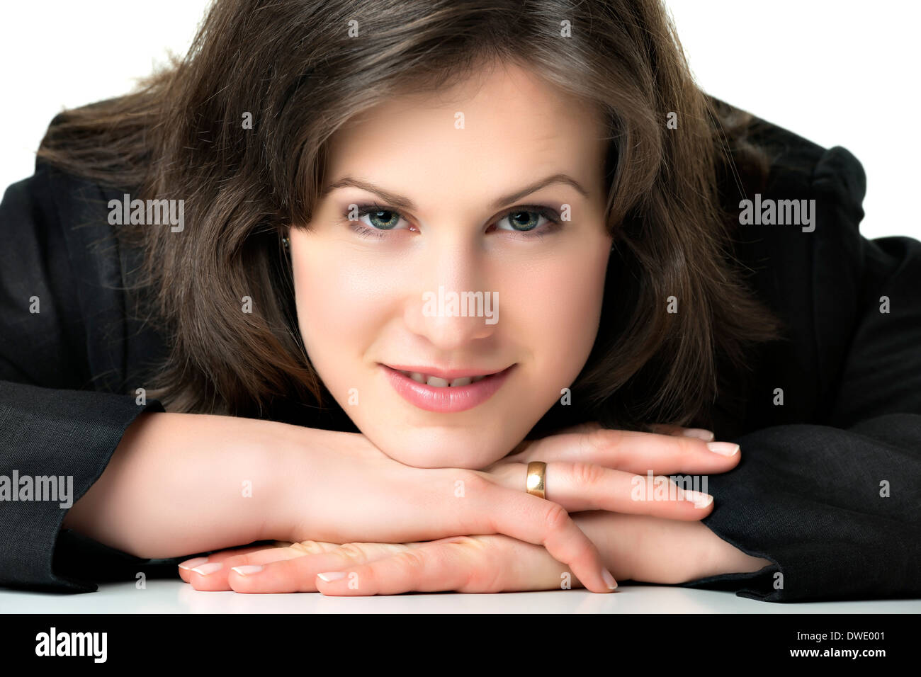 Headshot of a relaxed brunette business woman with black costume - Stock Image