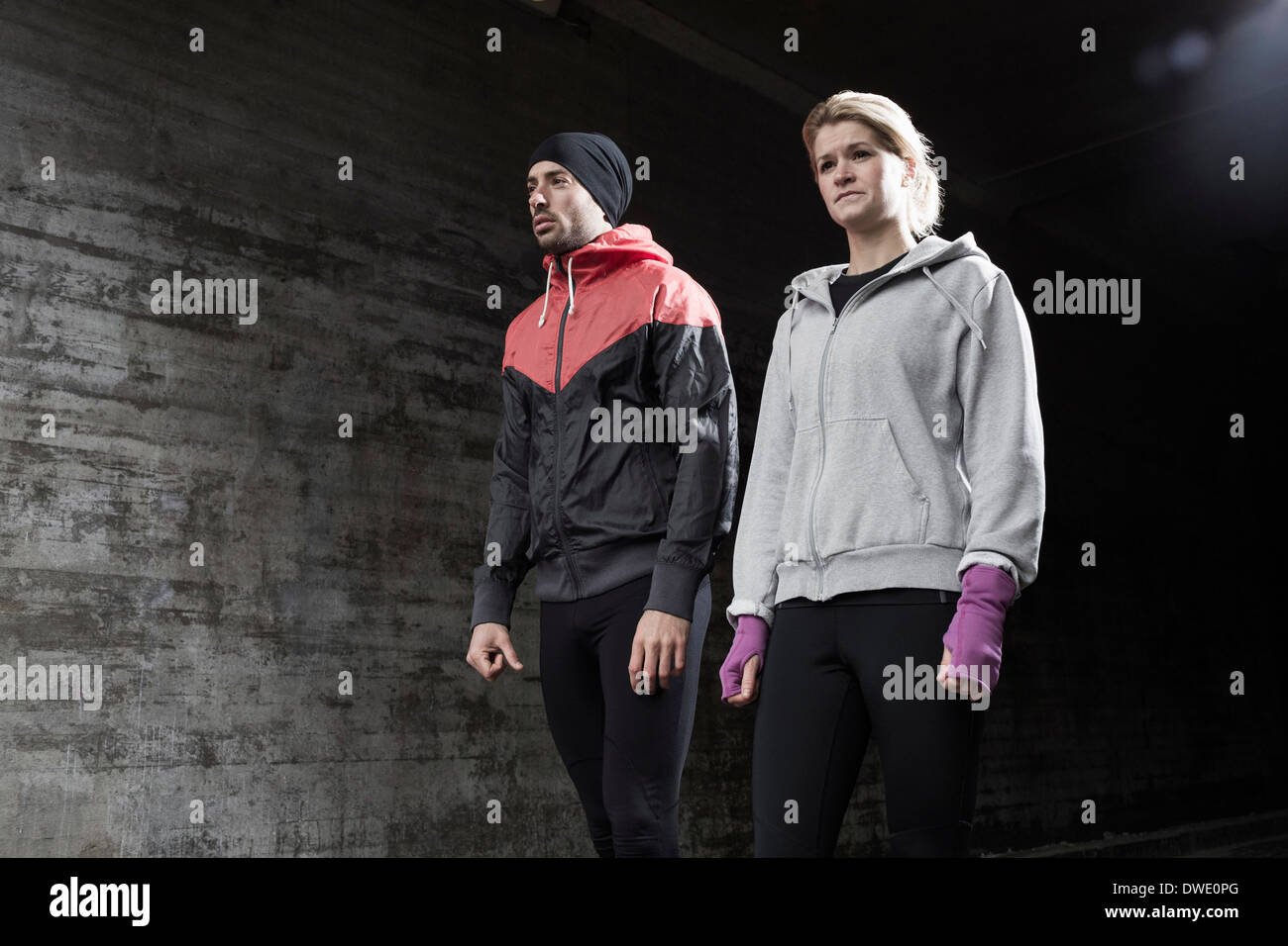 Sporty couple standing in tunnel Stock Photo