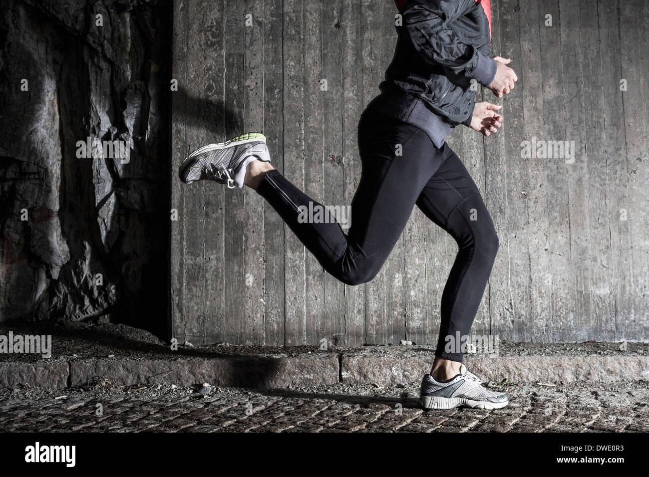Full length of man running in tunnel Stock Photo