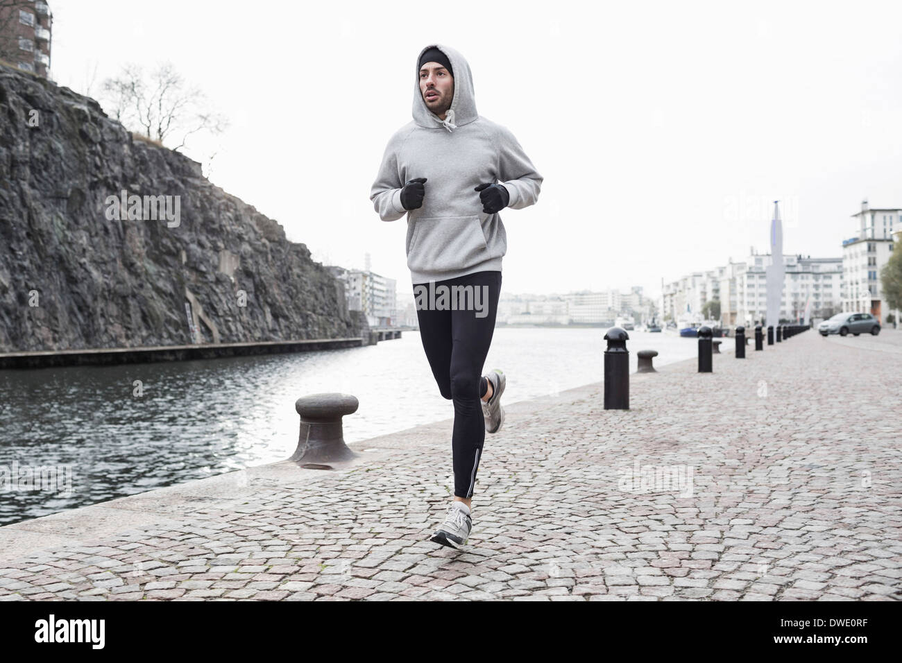 Man jogging at canal side - Stock Image