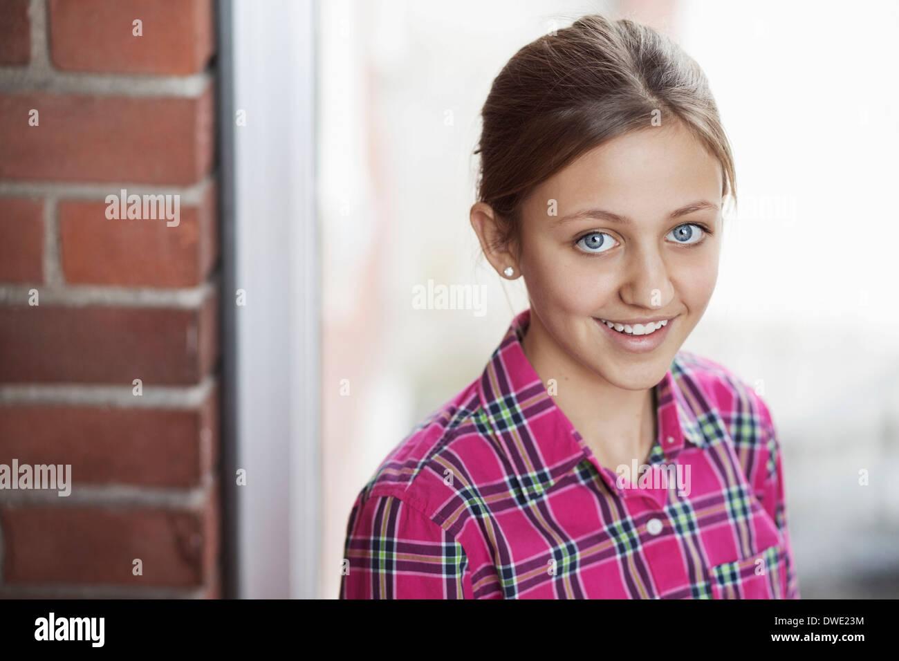 Portrait of happy female student in school - Stock Image
