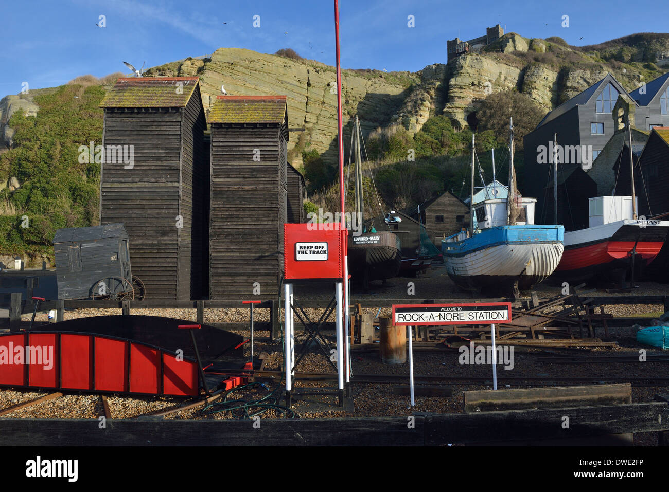 Rock-a-nore miniature railway station, fishing net huts, boats and east hill. Hastings - Stock Image