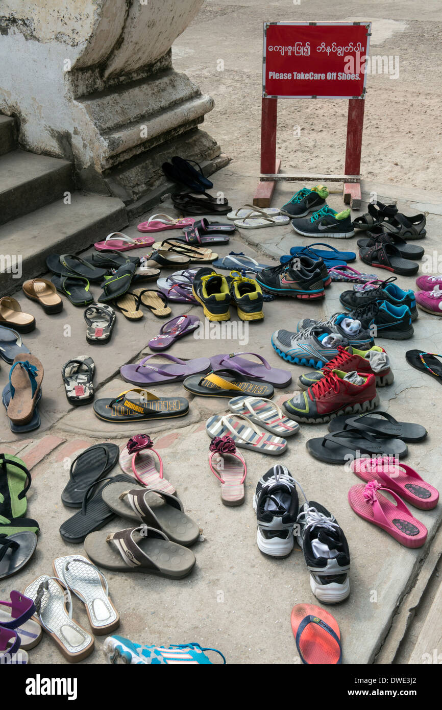Shoes at the entrance to a Buddhist temple in Mandalay in Myanmar (Burma) Stock Photo