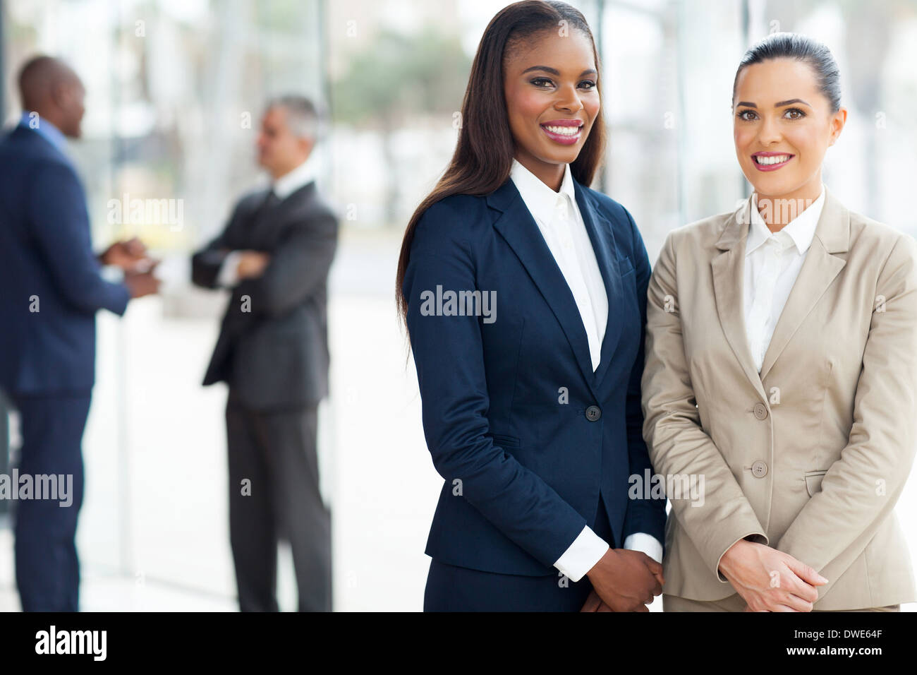 beautiful business women in modern office - Stock Image
