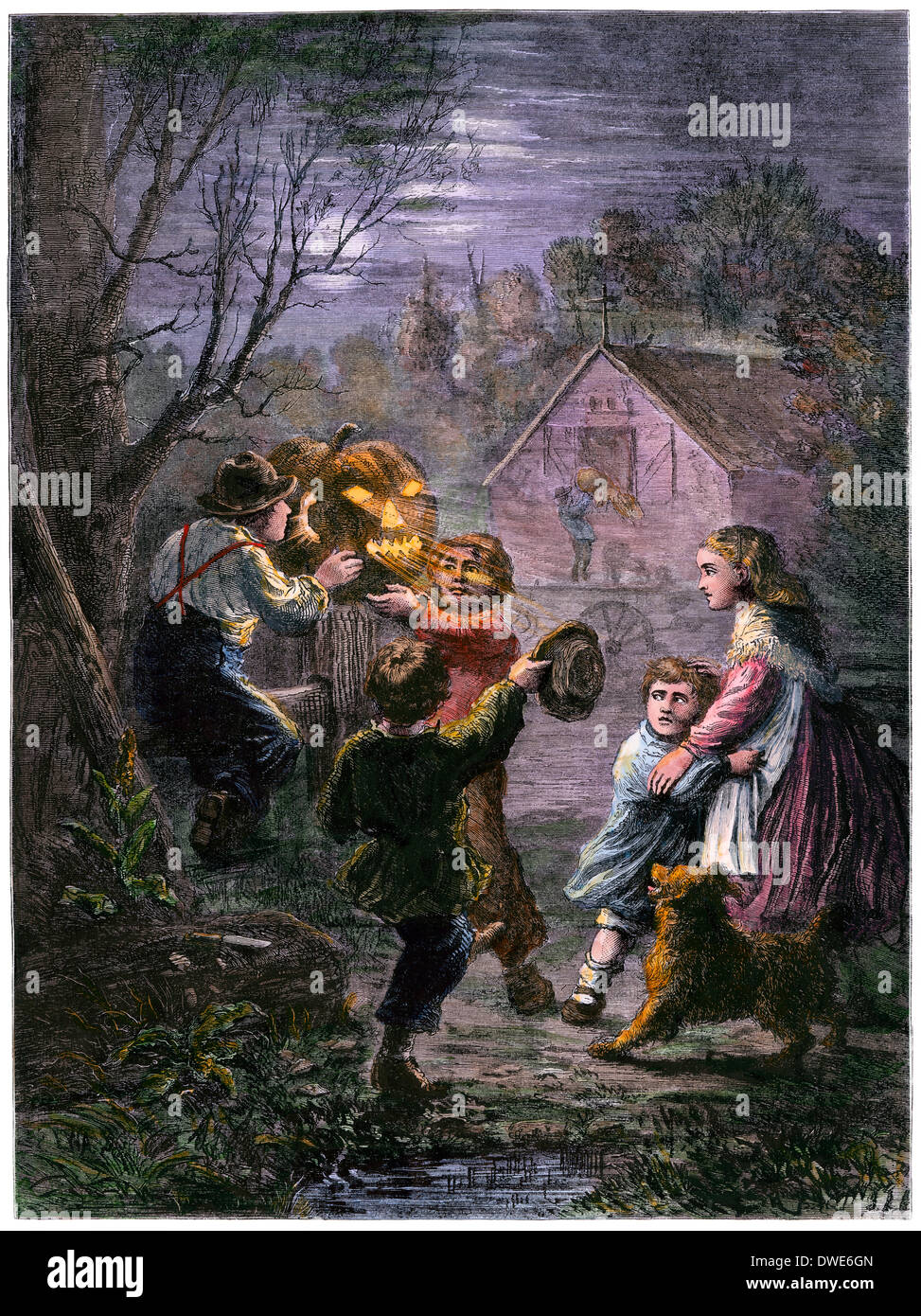 Children with a Halloween jack-o'lantern, 1860s. Hand-colored woodcut - Stock Image