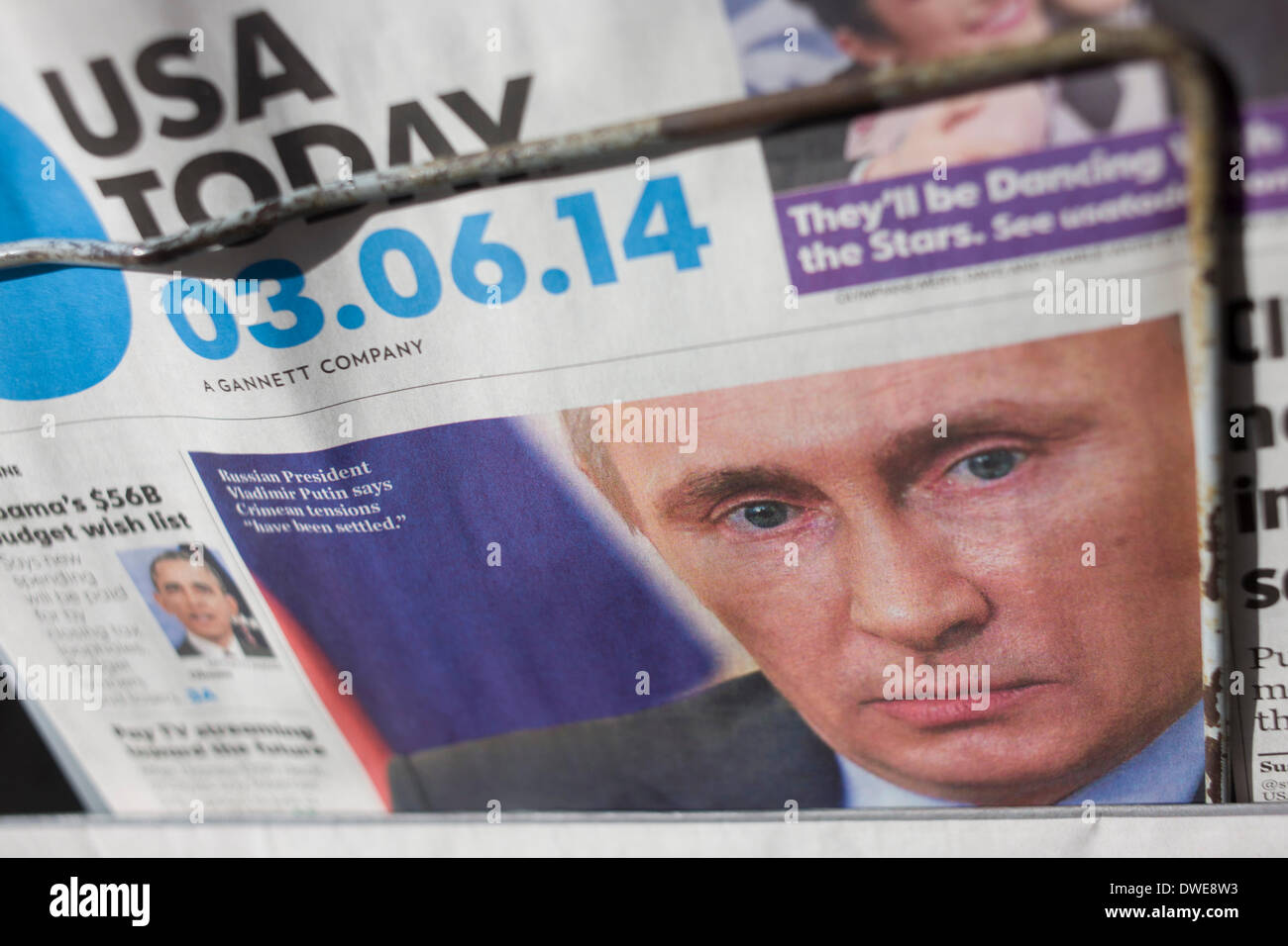 London, 6th March 2014: The face of Russian President Vladimir Vladimirovich Putin looks out from a news stand rack, appearing on the front page of American global newspaper USA Today, a Gannett-owned title. Copyright Richard Baker / Alamy Live News 03/06/14 - Stock Image