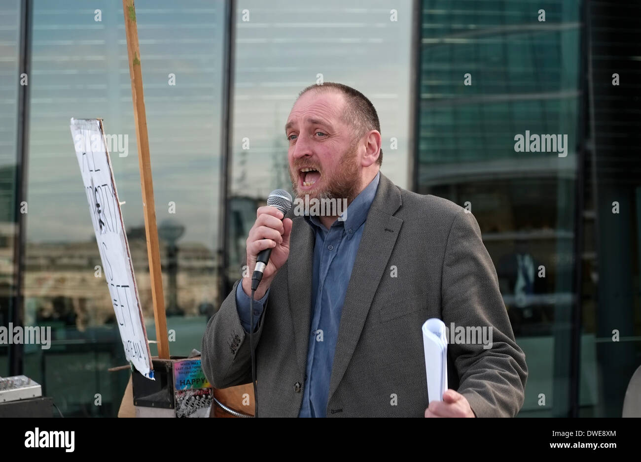 London, UK. 6th March 2014. A London assembly member talks as Londoners gather to protest against the Mayor's involvement in MIPIM a property fair in Cannes. Credit:  Rachel Megawhat/Alamy Live News - Stock Image