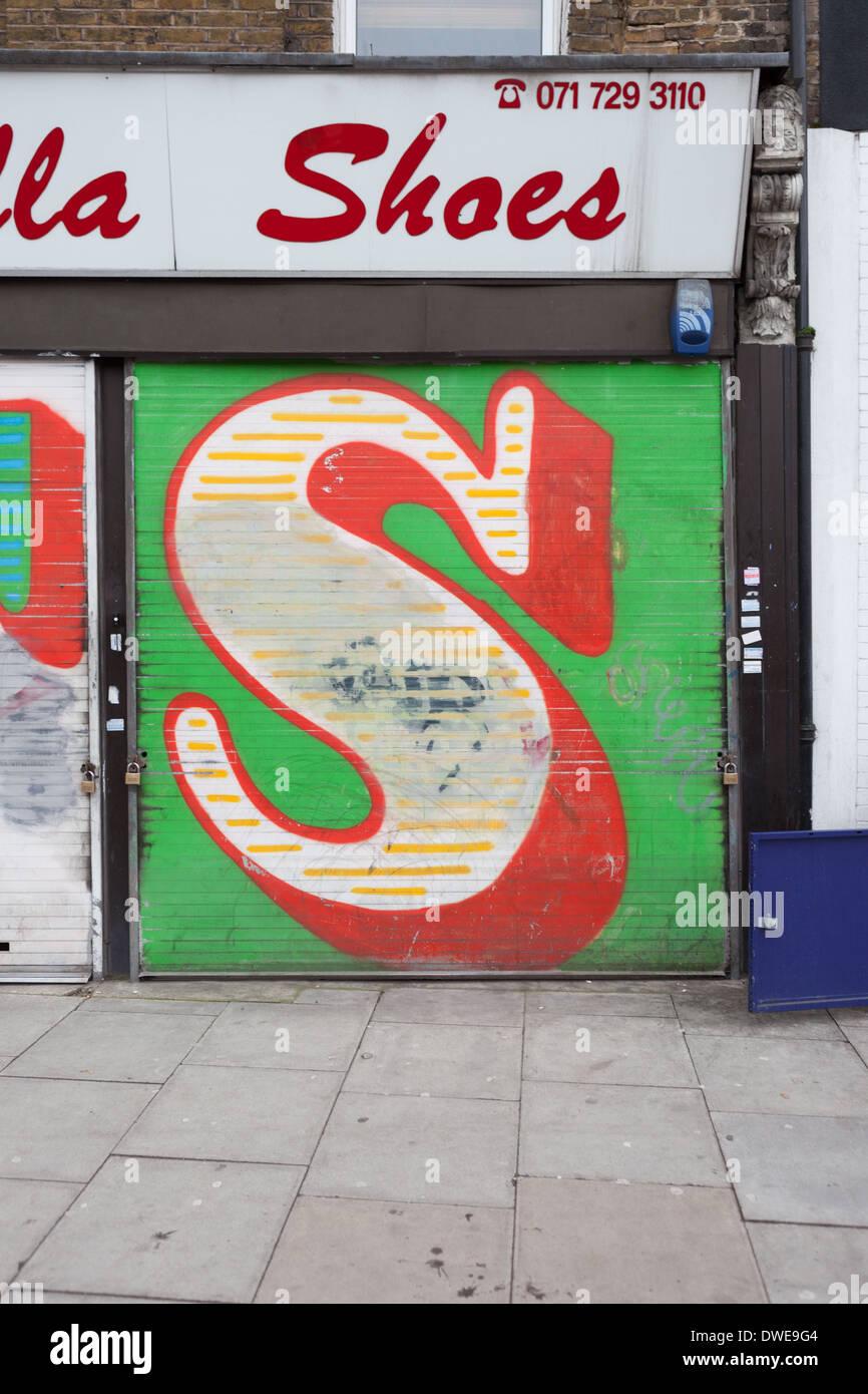 Ben Eine letter S in Shoreditch, London. - Stock Image