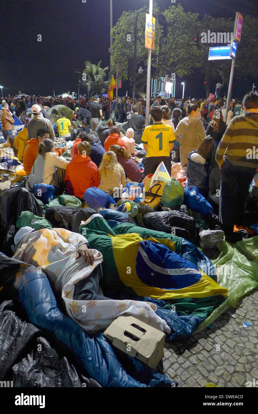 Pilgrims camped out on the streets of Copacabana for the all night Saturday vigil, leading to final mass on Sunday 28/6/13 - Stock Image