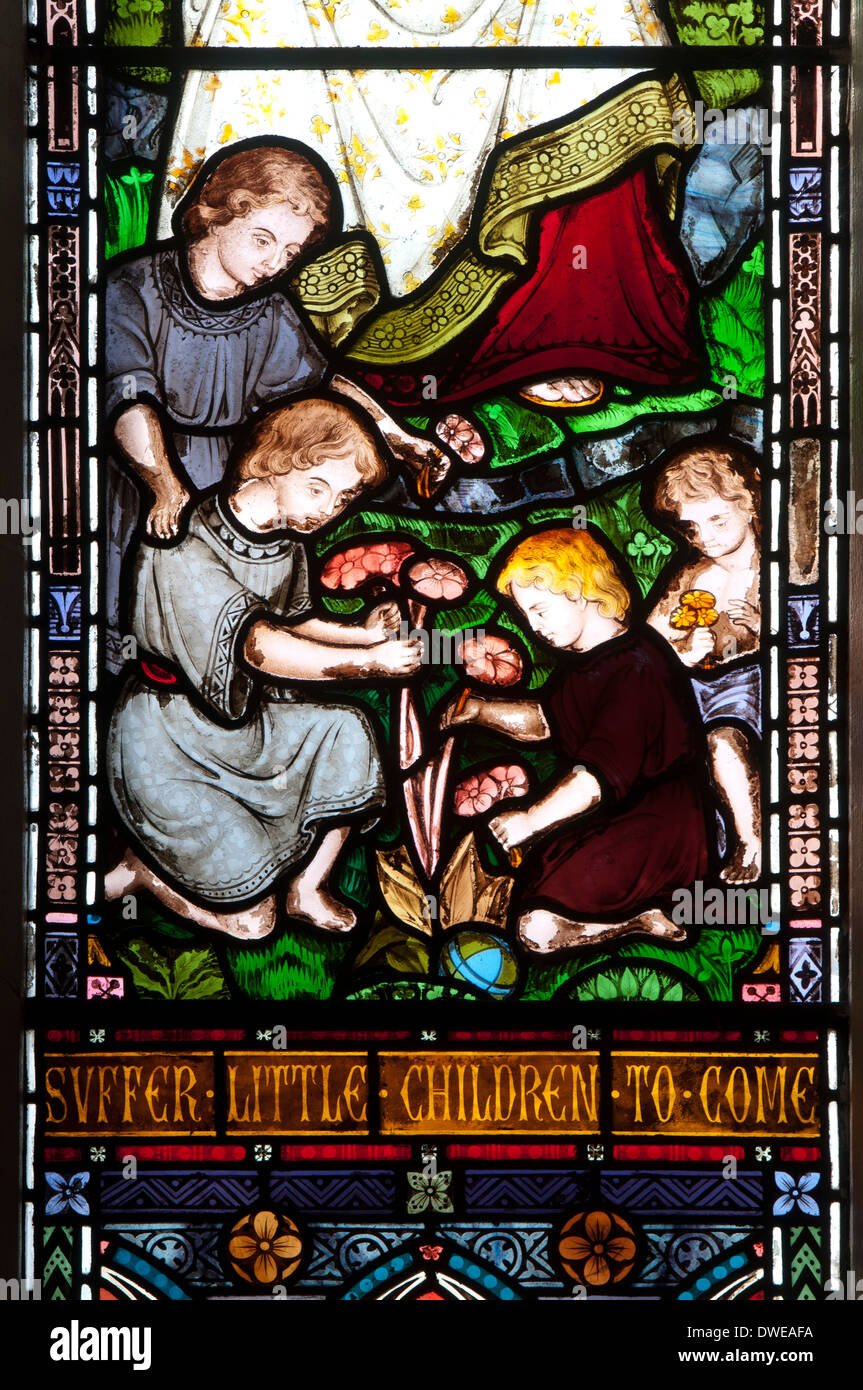 Suffer the little children stained glass, St. Stephen`s Church, Redditch, Worcestershire, UK - Stock Image