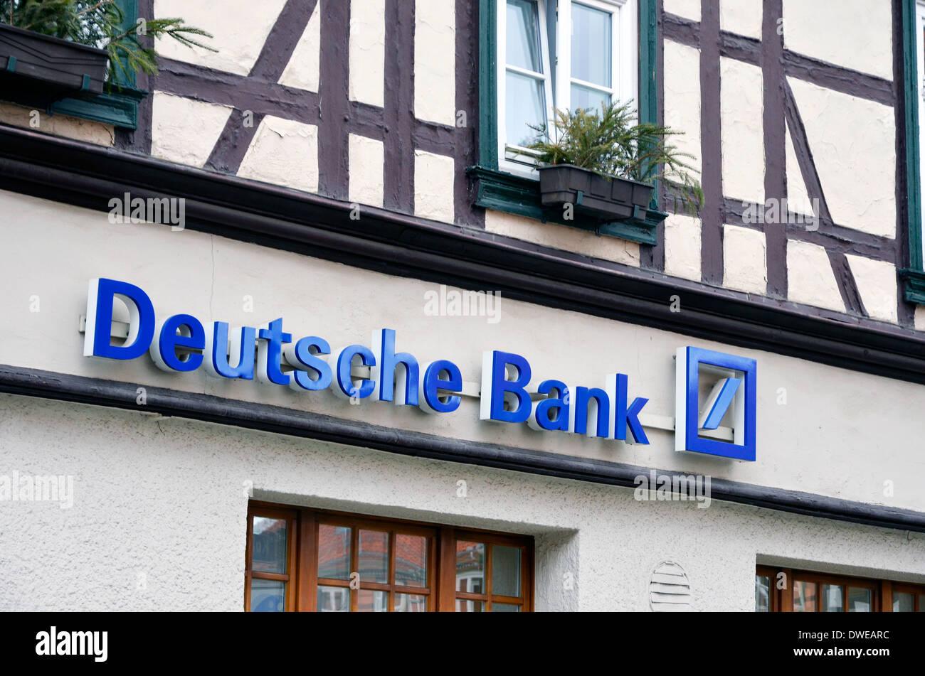 Deutsche Bank sign and logo on a traditional building in Wernigerode. Deutsche Bank Zeichen und Logos - Stock Image