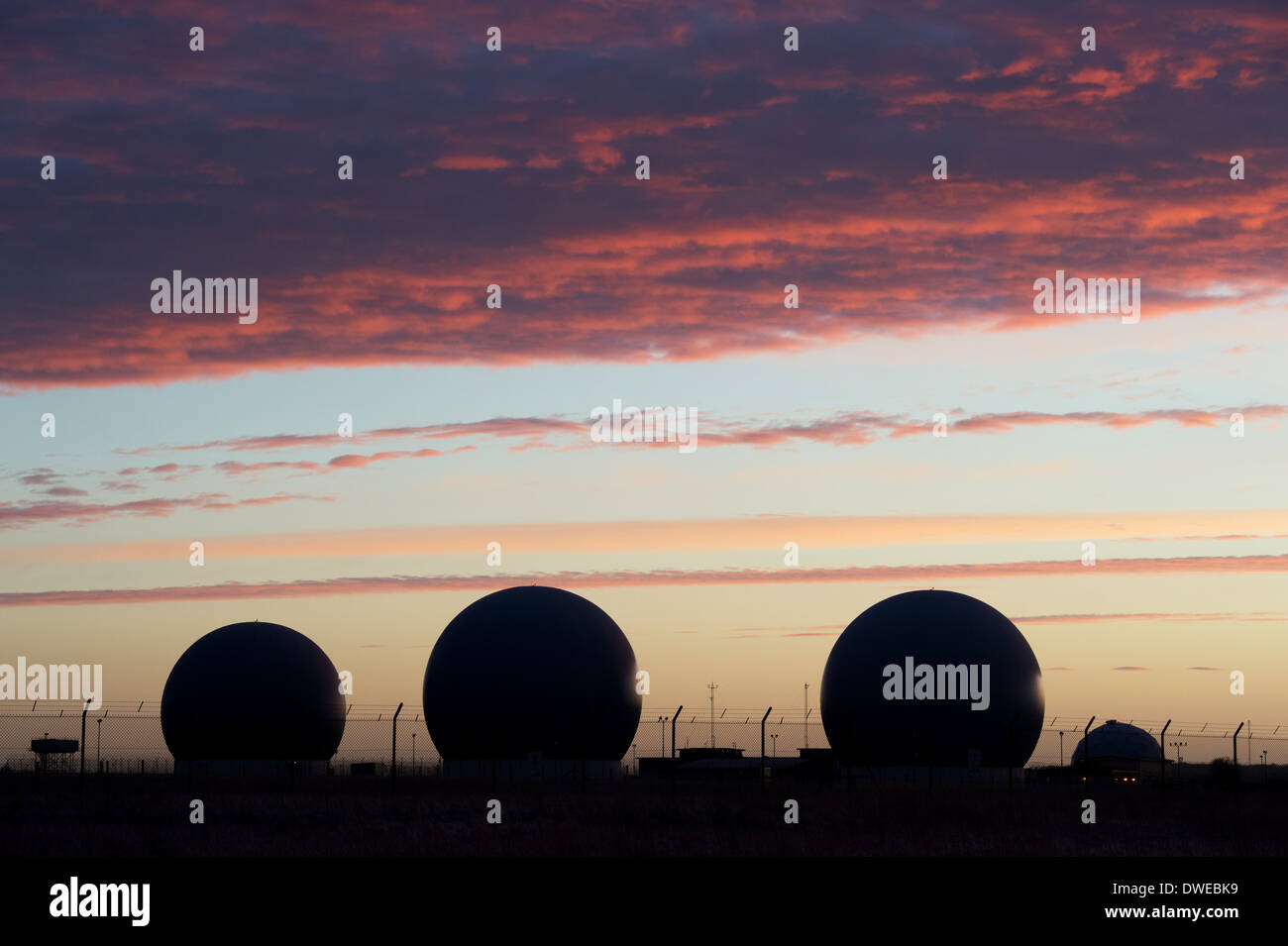Domes covering radar scanners at RAF Croughton. Northamptonshire, England at dawn. Silhouette - Stock Image