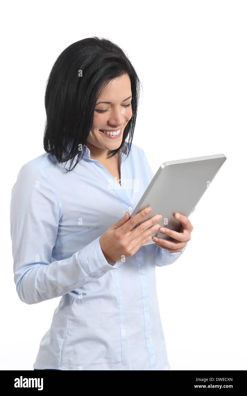 Happy woman reading a tablet reader isolated on a white background - Stock Image