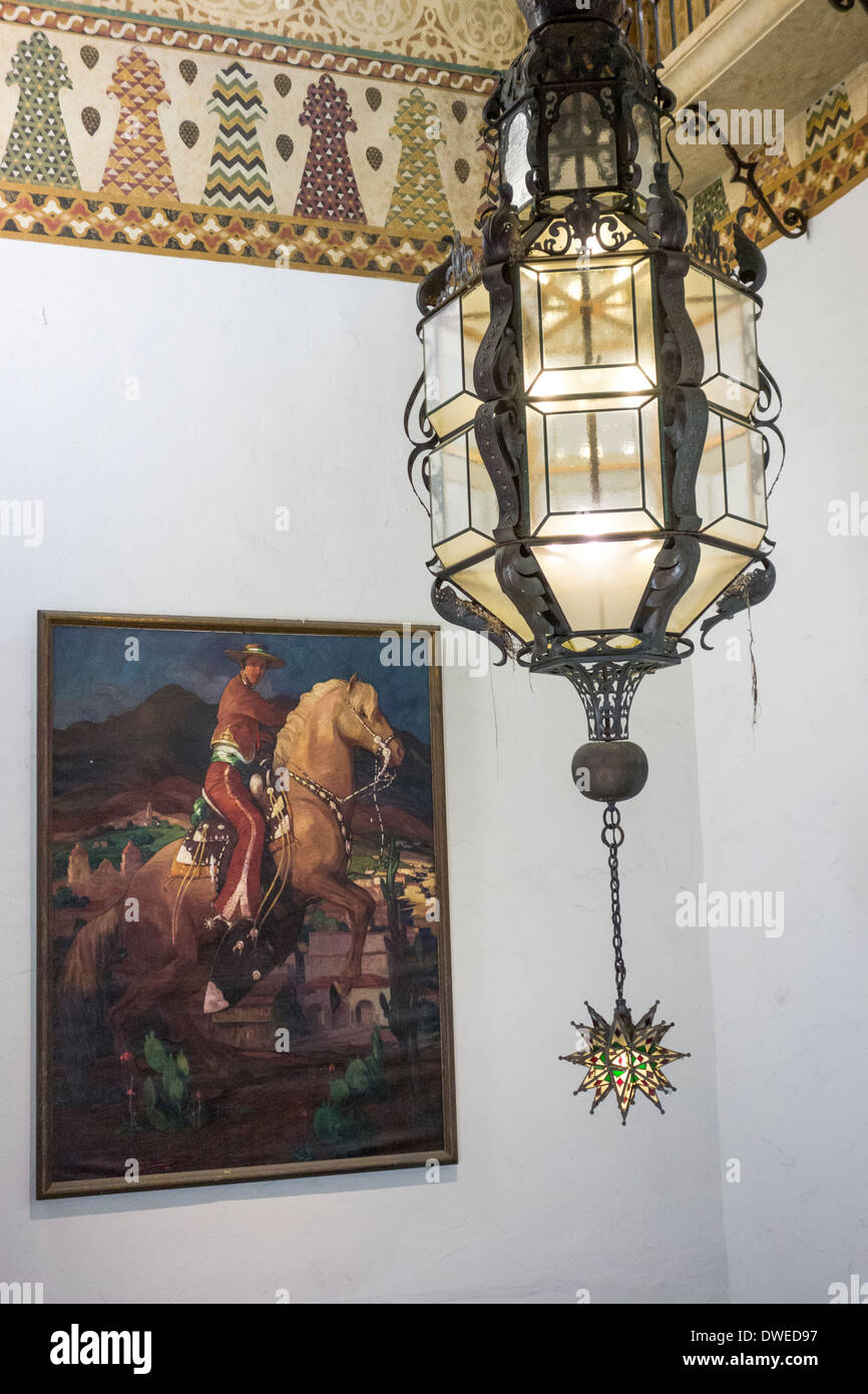 hanging lantern and painting on wall of County Courthouse; Santa Barbara; Santa Barbara County; California USA - Stock Image