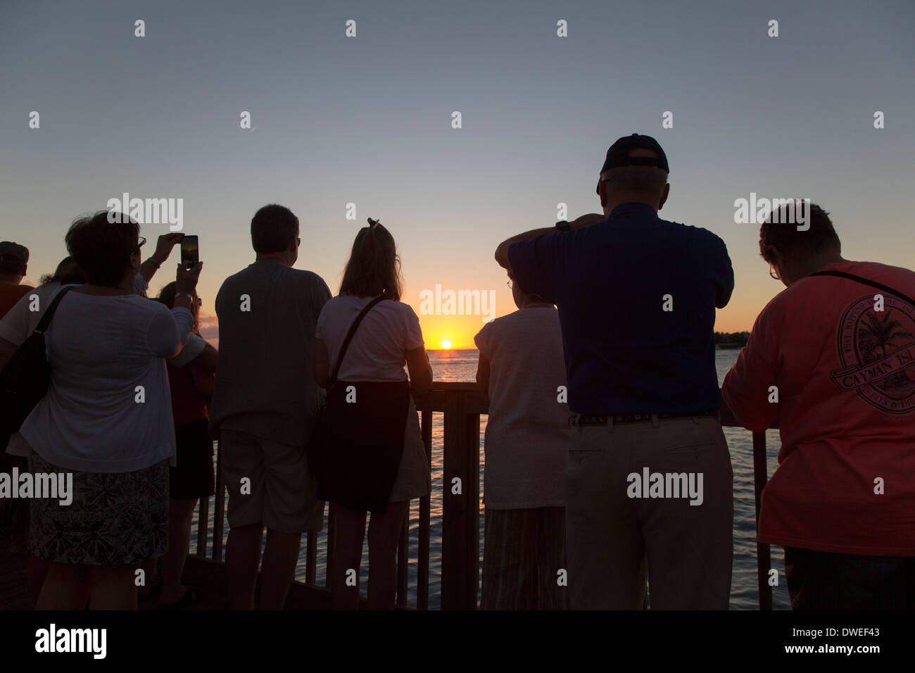 Key West, Florida - Tourists gather in Mallory Square to watch the sunset. - Stock Image