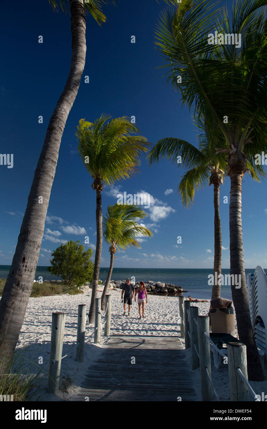 Key West, Florida - A couple on a beach at Key West. - Stock Image