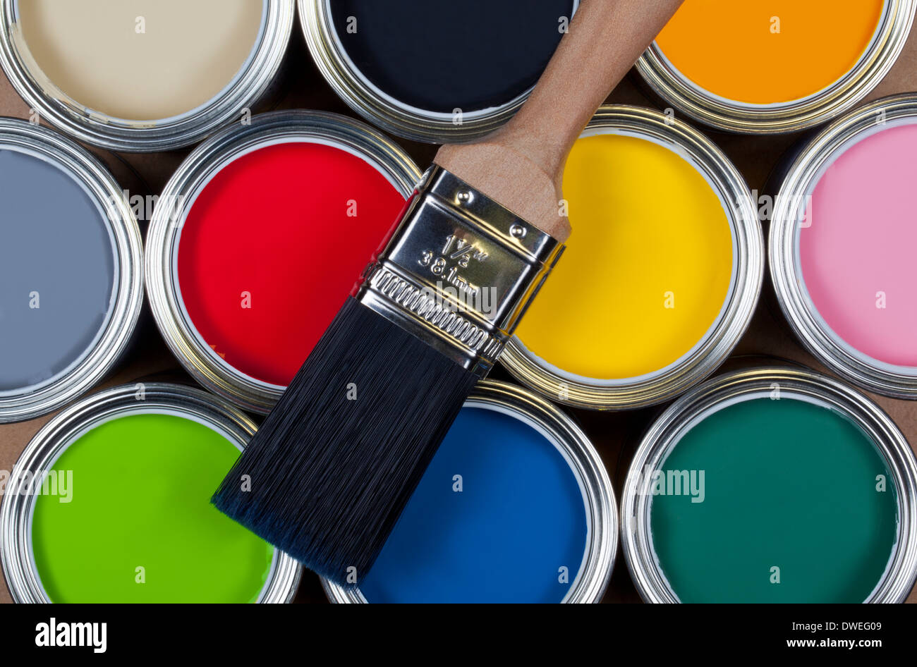 A selection of tins of colorful emulsion paint - Stock Image