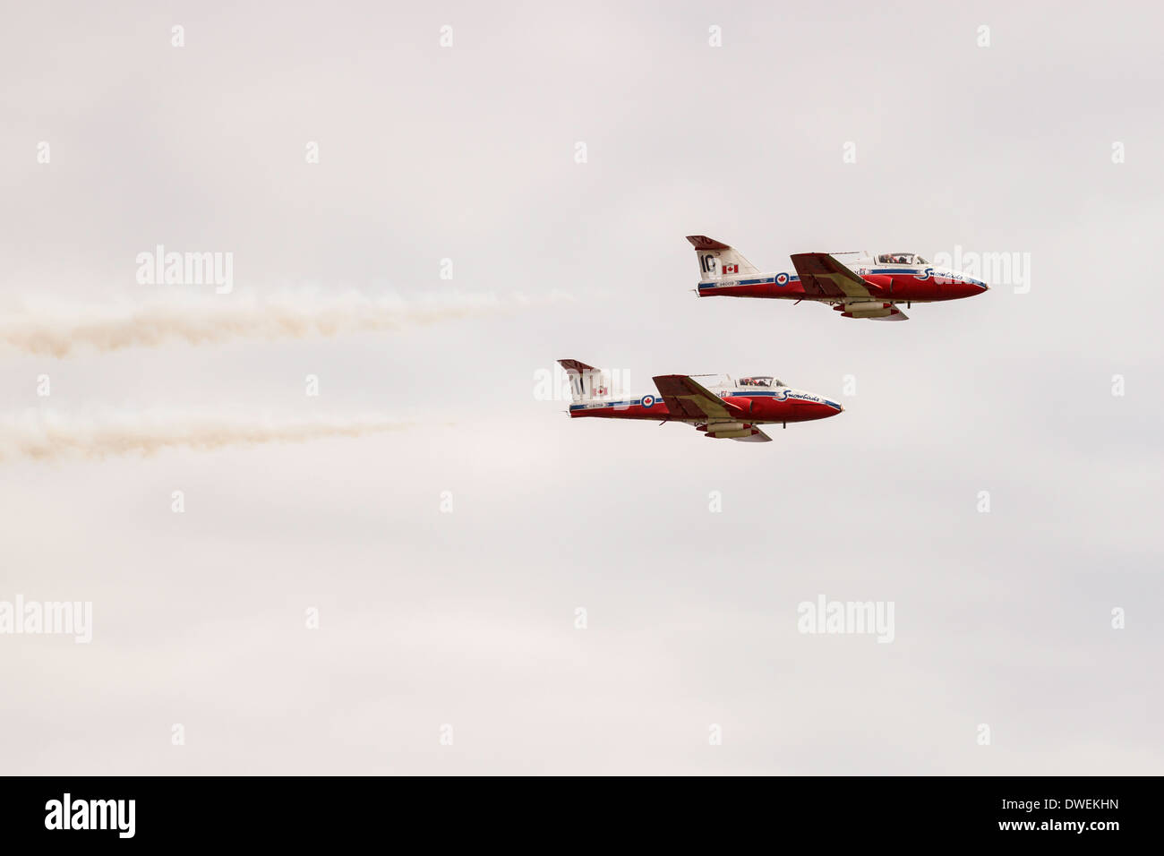 Two Canadian Snowbird aircraft flying in formation. Stock Photo