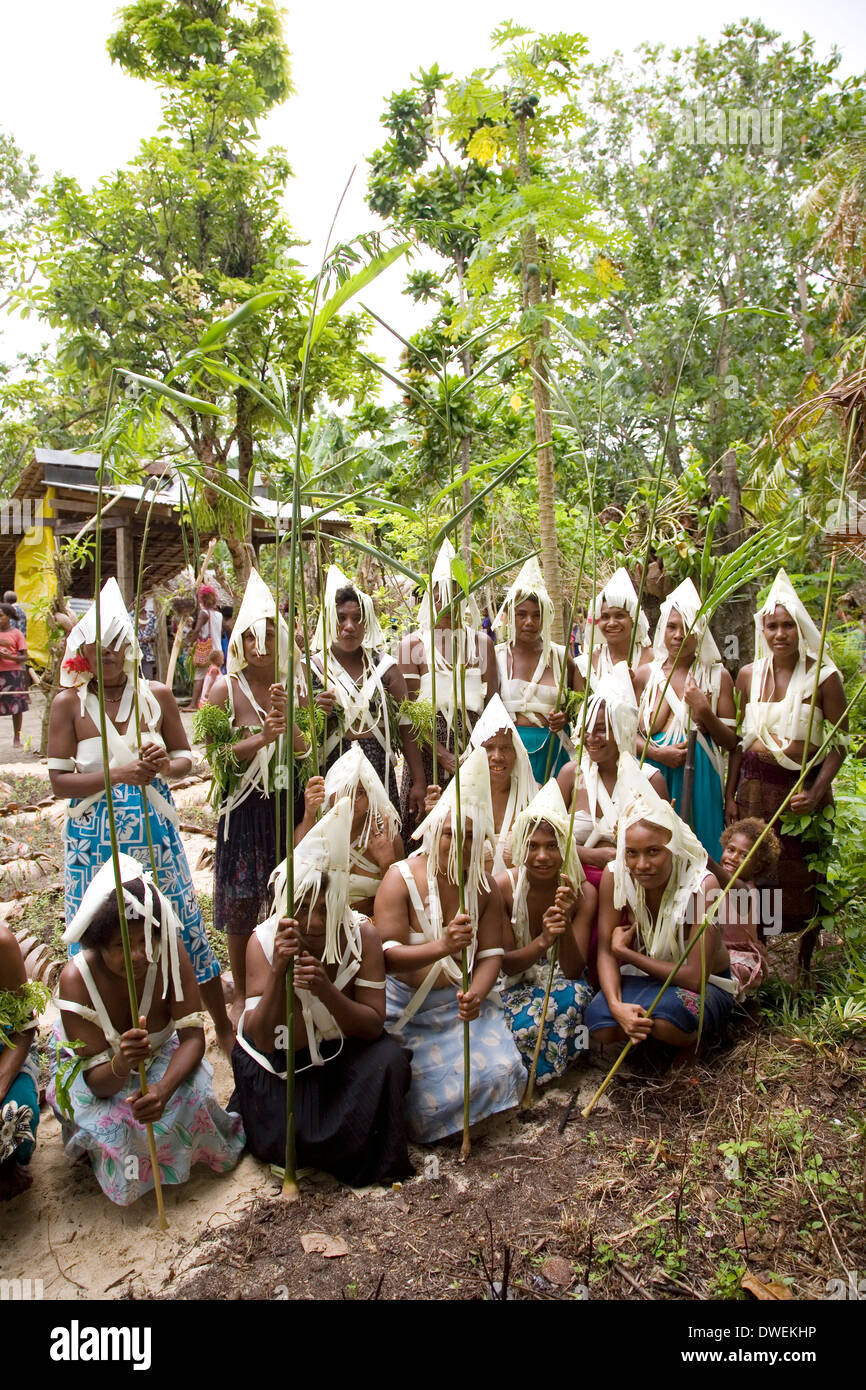 A young group of dancers from Nafinuatogo Village with costumes made from banana trees, Santa Ana Island, Solomon Islands - Stock Image
