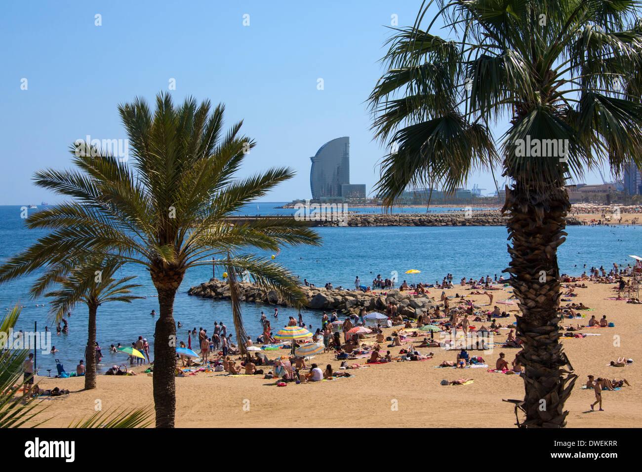 One of Barcelona's beaches (Platja de la Nova Icaria) near Port Olimpic in Barcelona in the Catalonia region of Spain. - Stock Image