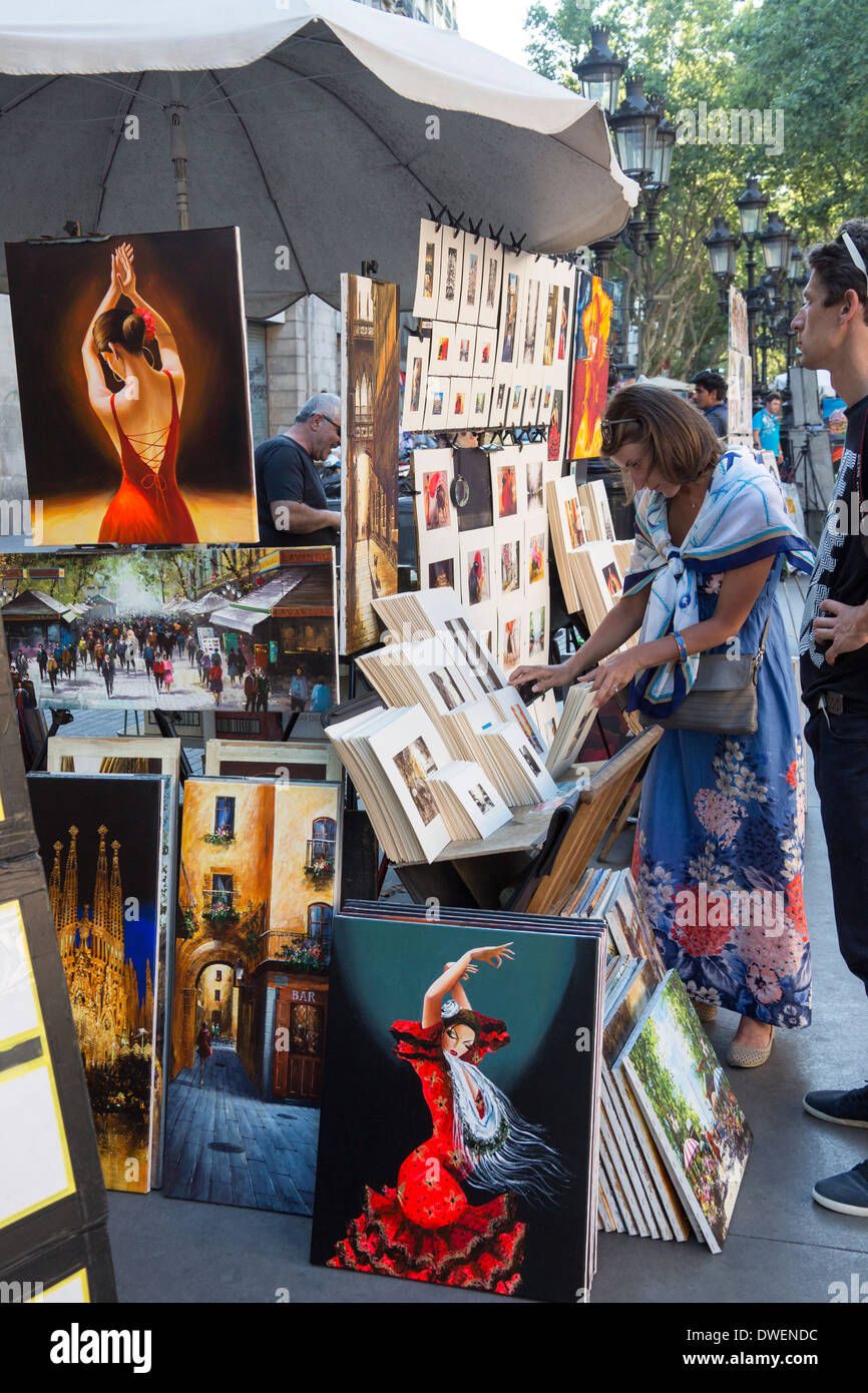 Tourists at a market stall on Las Ramblas in the city of Barcelona - Catalonia region of Spain - Stock Image