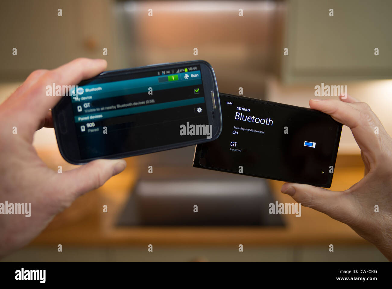Two untethered smartphones communicating via Bluetooth technology - Stock Image