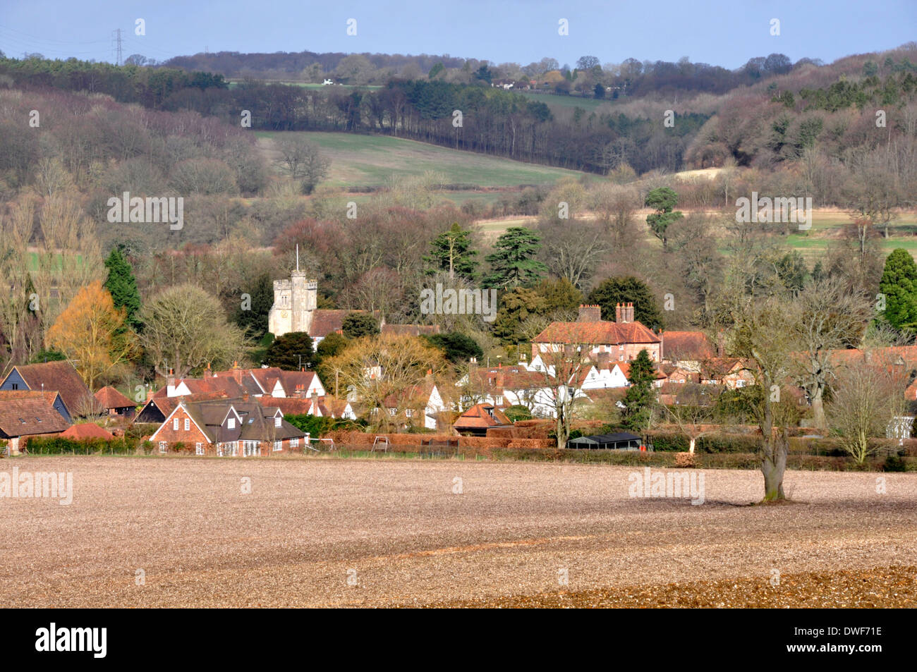 Bucks - Chiltern Hills - sunlit winter landscape - Little Missenden village - backdrop wooded hillsides - subtle muted colours - Stock Image