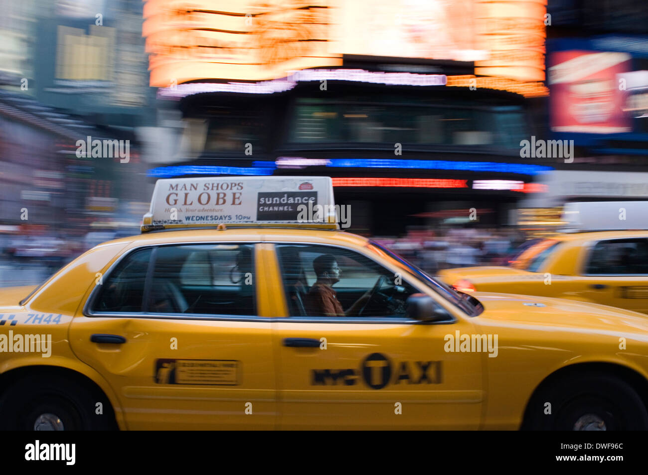 A taxi driver walking around Times Square, but this traditional postcard invaded Times Square yellow taxis will go down - Stock Image