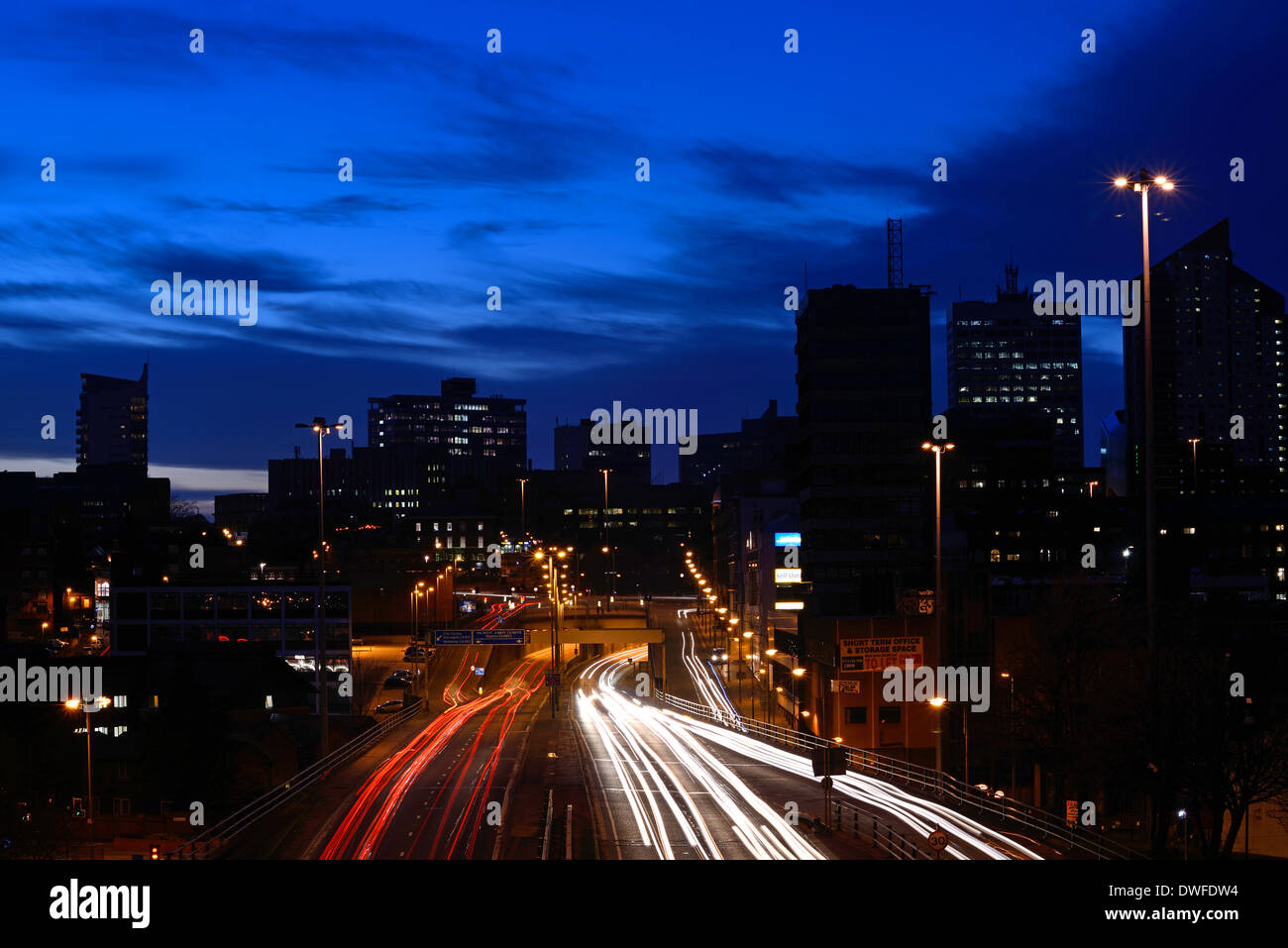 traffic trails of traffic heading too and from the city of leeds at dusk leeds yorkshire uk - Stock Image