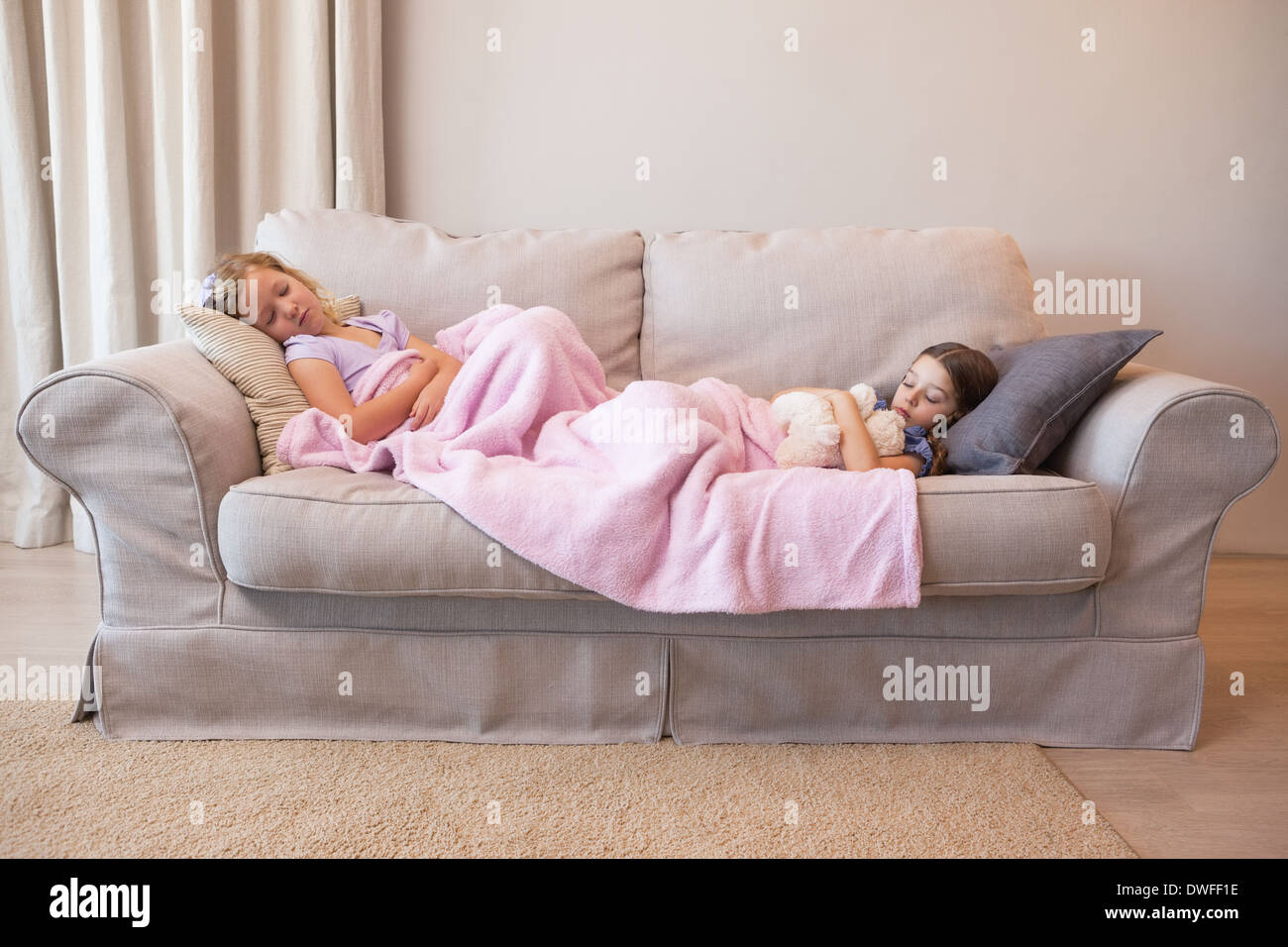 Magnificent Two Young Girls Sleeping On Couch Stock Photo 67338586 Alamy Machost Co Dining Chair Design Ideas Machostcouk
