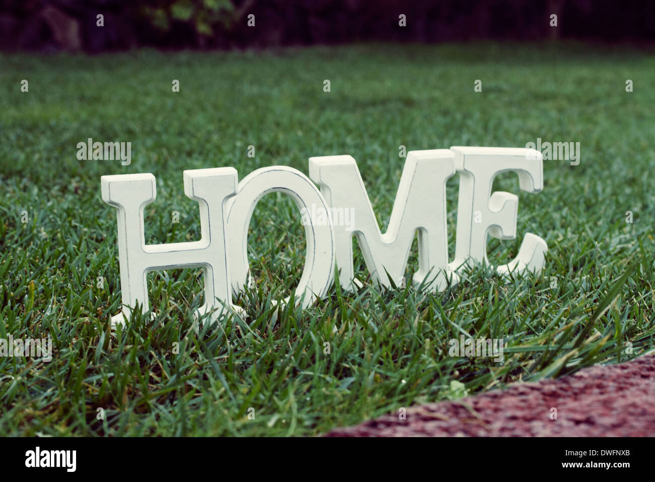 Home sign on grass - Stock Image