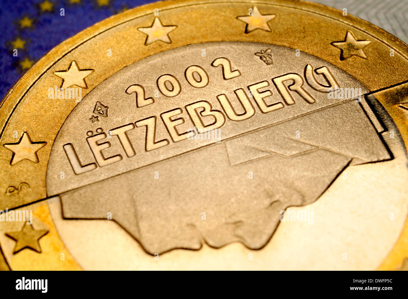 Luxembourg 1 Euro coin on €5 note - Stock Image