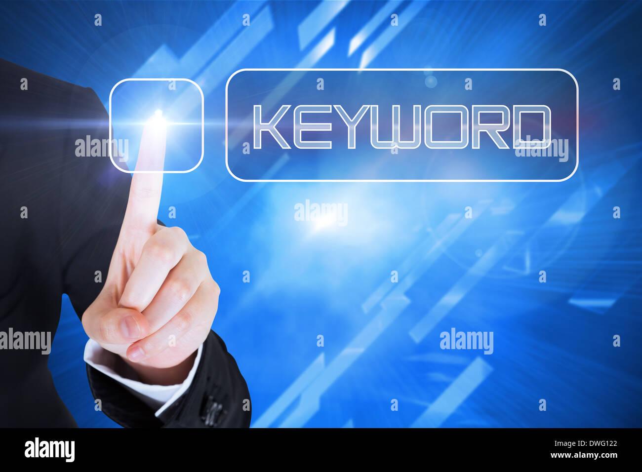 Businesswomans finger touching Keyword button - Stock Image