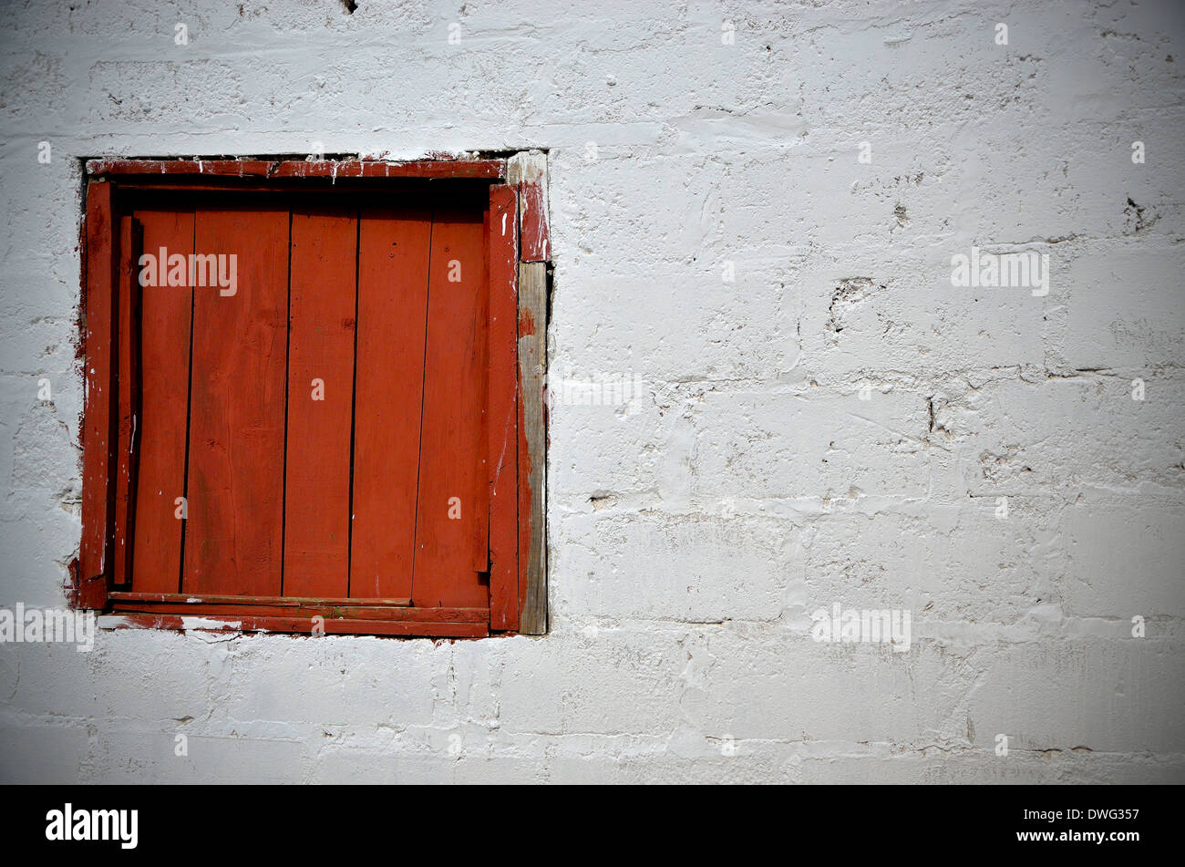 Window and white wall. Angola. - Stock Image