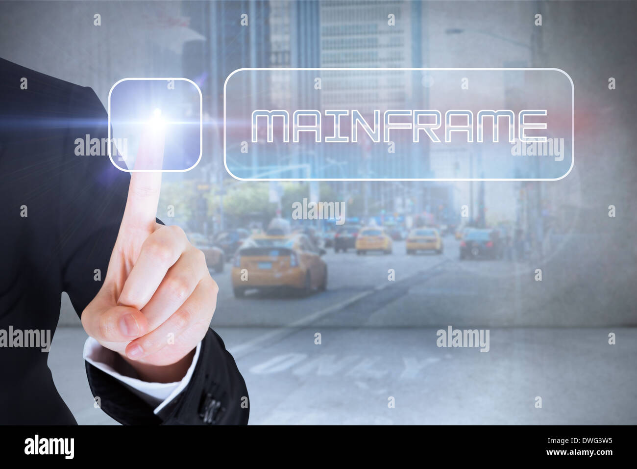 Businesswomans finger touching Mainframe button - Stock Image